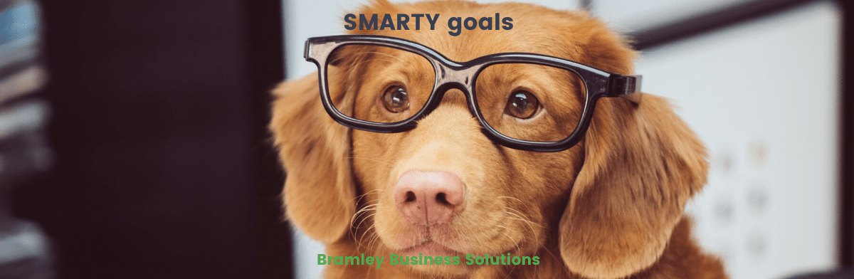 Dog in glasses looking smart for SMARTY goals