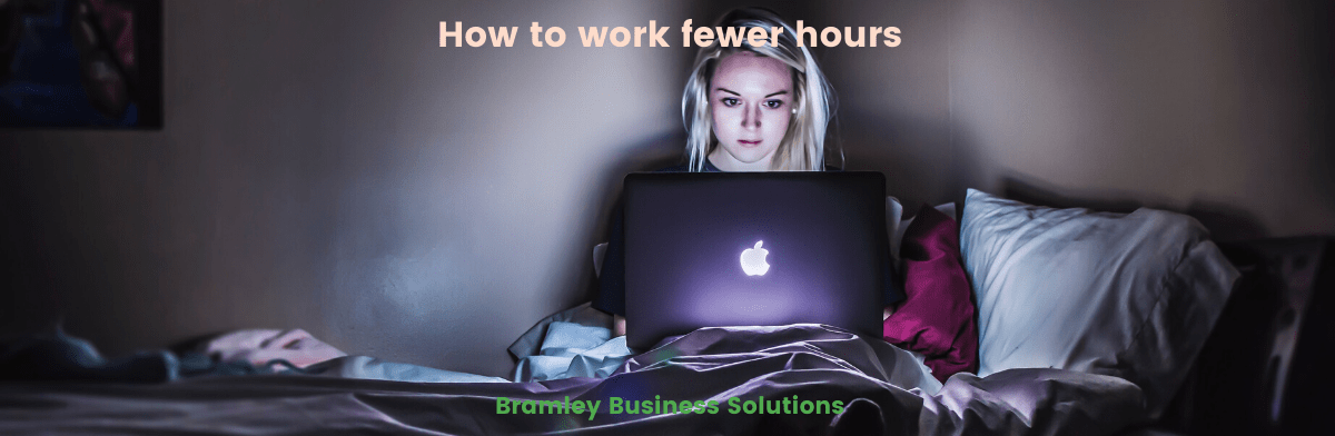 """Title image for blog """"how to work fewer hours"""" by Bramley Business Solutions, background contains a woman working on a laptop in bed in the dark"""